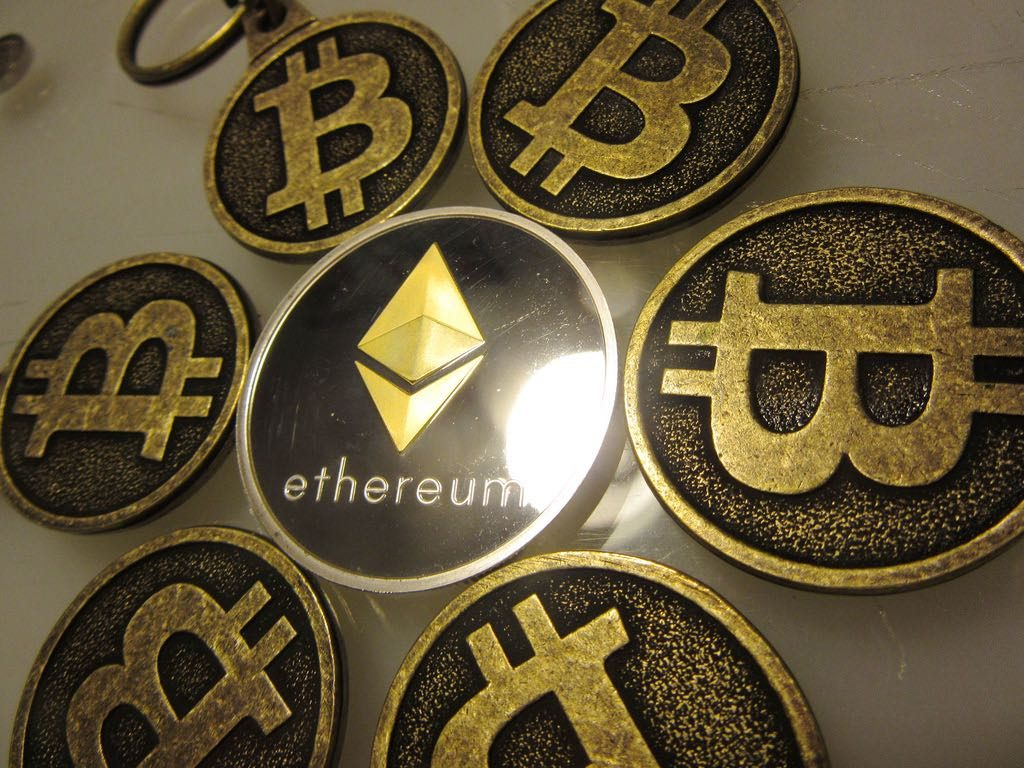 An Ethereum token surrounded by Bitcoins